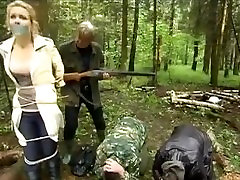 Russian TV Blonde tied to a tree in the woods