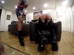 Mistress Mariam Caning her slave in Latex
