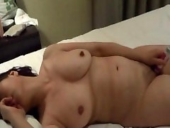 Mature Asian masturbating with a sex toy