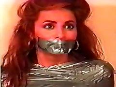 Girl mummified by girl