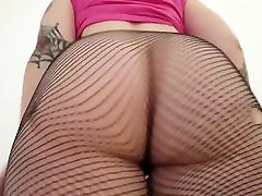 Pale goth chick shows her big butt in tube pm stockings.