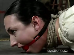 Hanging upside down submissive brunette bitch has to suck black dildo