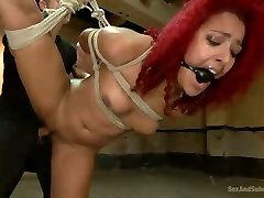 Bondageable curly ginger MILF gets properly fucked in standing position