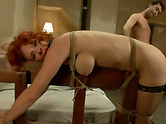 Tied up and gagged redhead gets brutally fucked doggy style hard