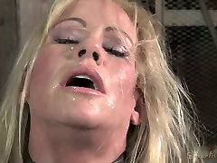 Chained down blond mom Simone Sonay rests after hard BDSM 3 some