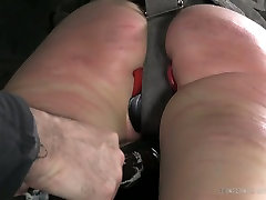 Dirty whore with plug in her mouth hole gets her ass spanked