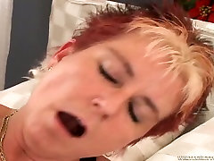 Hot breatsmilk japanese woman gets her pierced pussy fucked with a black cock