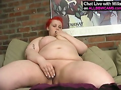 Red haired doggy with big ass slut stuffs her fat pussy with knobby big dildo