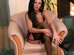 Alluring brunette babe takes black stocking out of her shaved pussy