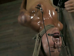 Oil covered black chick Skin Diamond gets tied up and hung above the floor