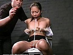 Asian slave Koko in tit tortures and oriental bdsm of naughty teen submissive to