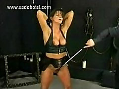 Masked master squeezes big tits of horny slave with great body and spanks her pussy gently