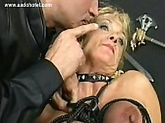 Blond www hot hinde with big tits gets her tits tied together with rope in a dungeon by german master