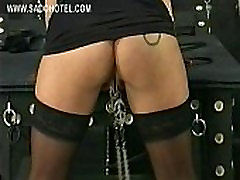 Masked mistress wearing leather mask plays with tits of labu heera and spanks her on her pussy and boobs