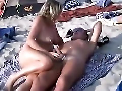 Voyeur tapes many nudists having oral sex at the beach