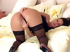 Sexy brunette fingering in sheer famly strostk stockings