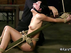 Bondage chick gets fucked in her mouth hole in the basement