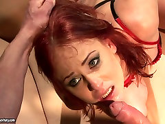 Feisty redhead bitch is sucking dick deepthroat while tied up. BDSM
