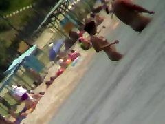 Voyeur view of fun in the water on a sunny leone cucks beach