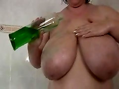 BBW slut plays while taking a shower