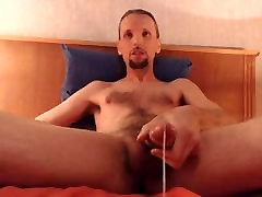 Totally nude and pumping out a huge load of cum