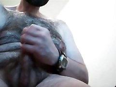 Hairy bear shooting loads of cum