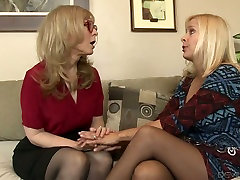 Mature milf Nina Hartley fucks pussy with the help of strapon