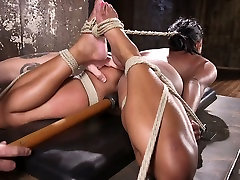 Bondage black hottie Maxine X is punished with the help of long stick