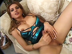 Tranny whore with nice tits strokes her cock