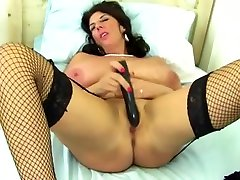 Huge titted mature brunette toying in stockings