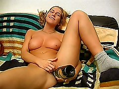 Busty amateur teen girlfriend toying with a bottle