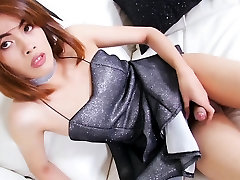 Beautiful ladyboy Gigi B strokes her hard dick on sofa