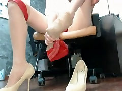 Woman plays with her masturbasi tete mulus in her office