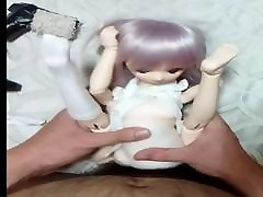 short haired doggy with doll