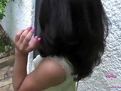 Keira Verga by the black door