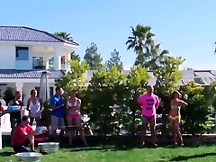 Swinger wives play around with the guys by the poolside
