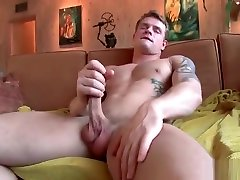 Muscled guy with tats jerking on sofa part1