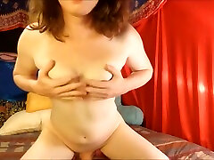 Tiny tit Tgirl plays with nipples and strokes thick cock