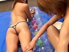 Asian lesbians massaging