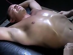Tattooed muscled hunk tickles bondaged twink with feathers