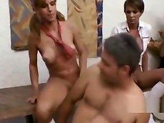 Horny trannies with big tits gang bang a guy