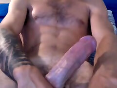 muscled tattoed hairy straight guy edging his big fat cock