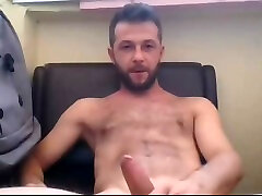 handsome muscled hairy straight guy jerking his big cock