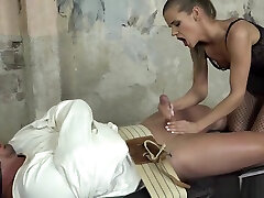 Femdom euro strokes subs dick during BDSM