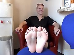 Blonde girl takes off her hind xxx mms socks to show off her beautiful bare feet