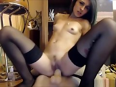 Girl in black different style for sex sitting on a black dildo