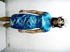 Hong Kong bezars sex house t-girl Shirley wearing Chinese qipao and a mask