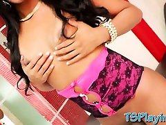 Sexy tranny in lingerie masturbates her thick cock