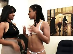 Black lesbians in sexy lingerie having sex at the office.