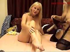 Lesbian MILFS having fun with a strap on